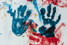 Blue paint handprints