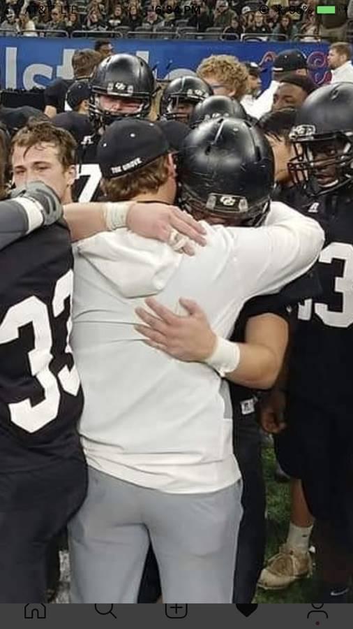 Football players hugging